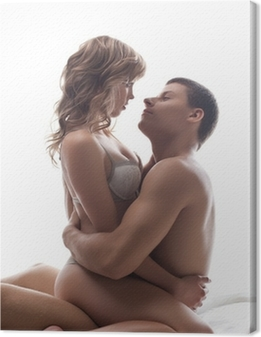 Tableau sur toile Couple amoureux ludiques assis dans son lit - jeux sexuels