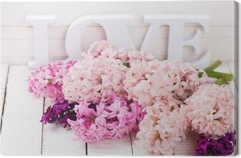 Tableau sur toile Des fleurs fraîches et mot amour