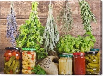 Tableau sur toile Diverses herbes fraîches et de la nourriture en conserve