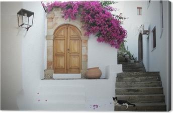 Tableau sur toile En Grèce: des murs blancs, des fleurs fuchsia, des escaliers et chat détente