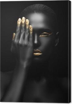 Tableau sur toile Femme à la peau sombre avec maquillage dorée.