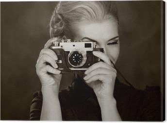 Tableau sur toile Femme en robe classique avec caméra rétro.