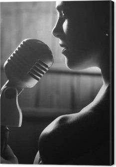 Tableau sur toile Femme sensuelle avec microphone