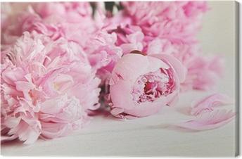 Tableau sur Toile Fleurs rose pivoine sur la surface du bois