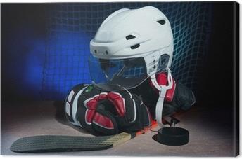 Tableau sur toile Gants de hockey, casque et bâton gisaient sur la glace.