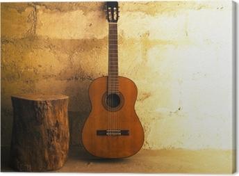 Tableau sur toile Guitare acoustique sur le vieux mur - atelier