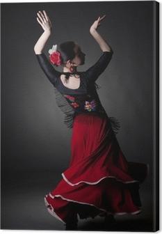 Tableau sur toile Jeune femme qui danse flamenco sur fond noir