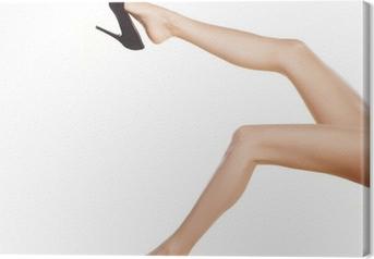 Tableau sur toile Jolies jambes de femmes en chaussures noires à talons hauts sur fond blanc