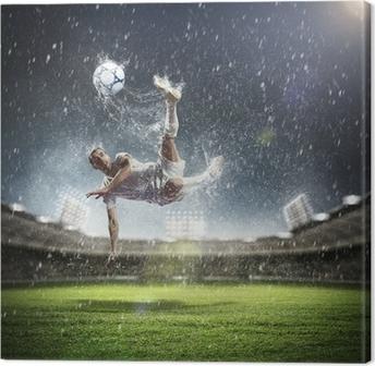 Tableau sur toile Joueur de football frapper la balle