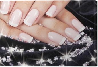 Tableau sur toile Les ongles de belle femme avec manucure et diamants français.