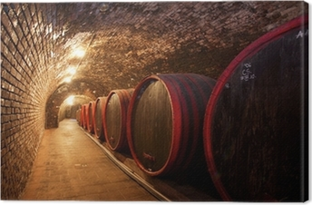 Tableau sur toile Les tonneaux de vin empilées dans l'ancienne cave de la cave
