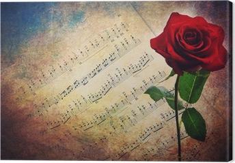 Tableau sur toile Partition musicale antique avec une rose rouge