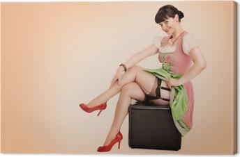 Tableau sur toile Pin up girl im Dirndl