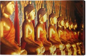 Tableau sur toile Rangée de statue en or de Bouddha