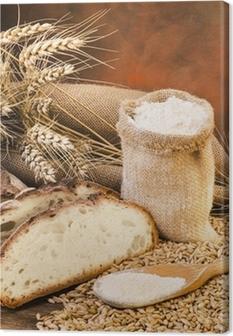 Tableau sur toile Sacco di farina con pane e spighe