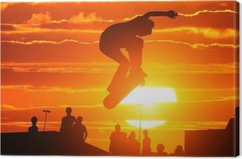 Tableau sur toile Saut extrême haute planche à roulettes de garçon de patineur