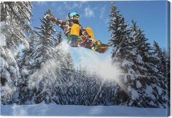 Tableau sur toile Snowboarders dans les pins