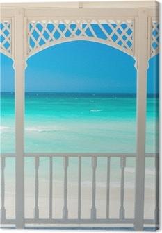 Tableau sur toile Terrasse en bois avec vue sur une plage tropicale à Cuba