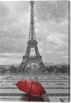 Tableau sur toile Tour Eiffel sous la pluie. Photo noir et blanc avec un élément rouge
