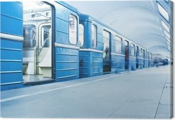 Tableau sur toile Train bleu sur la station de métro