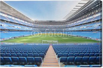 Tableau sur toile Vider stade de football extérieur avec des sièges bleus