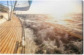 Tableau sur toile Voile au lever du soleil. yacht de luxe.