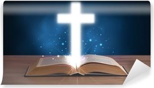 Avoin pyhä Raamattu hehkuva risti keskellä Vinyyli valokuvatapetti