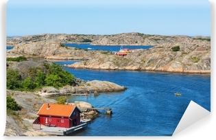 Punainen mökki meren rannalla Vinyyli valokuvatapetti