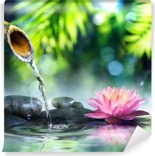 Zen-puutarha, jossa on mustat kivet ja vaaleanpunainen waterlily Vinyyli Valokuvatapetti