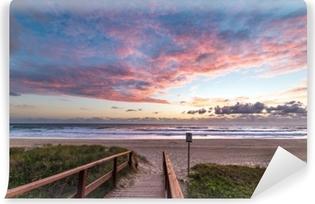 Episk strand landskab med solopgang himmel og strand indgangen Vaskbare Fototapet