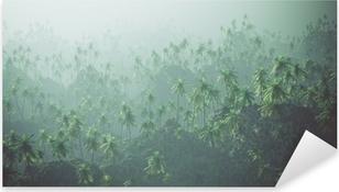 Vinilo Pixerstick Aérea del bosque de palmeras en la niebla.