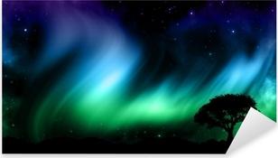 Vinilo Pixerstick Cielo nocturno con las luces norther con siluetas de árboles