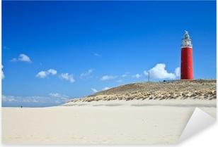 Vinilo Pixerstick Faro en las dunas en la playa