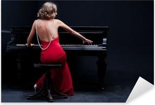 Vinilo Pixerstick Hermosa mujer joven y atractiva en vestido de coctel y piano