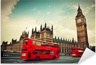 Vinilo Pixerstick Londres, Reino Unido. Bus rojo en el movimiento y el Big Ben