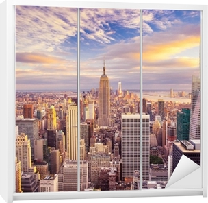 Vinilo para Armario Vista del atardecer de la ciudad de Nueva York con vistas a Manhattan