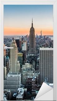 Vinilo para Puerta Horizonte de Nueva York al atardecer