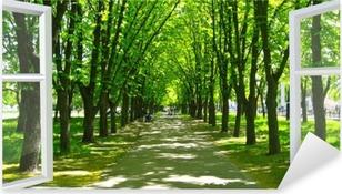 Vinilo Pixerstick Ventana abierta al hermoso parque con muchos árboles verdes