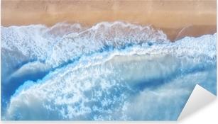 Vinilo Pixerstick Vista aérea sobre las olas. hermoso paisaje marino natural desde el aire