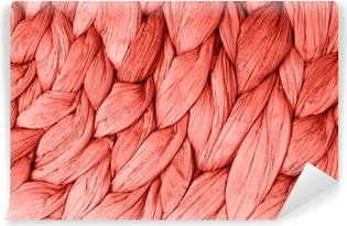 Abstract woven mat texture background living coral color. Trendy concept color of the year. Vinyl Wall Mural