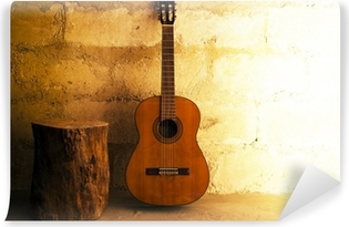 Acoustic guitar on old wall - copyspace Vinyl Wall Mural