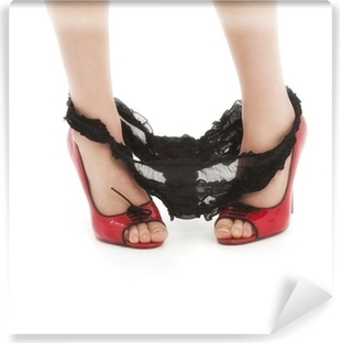 Beautiful woman in red high heels with panties around ankles Vinyl Wall Mural
