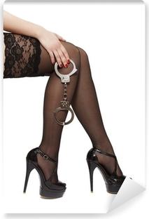 Beautiful woman legs in high heels and handcuffs Vinyl Wall Mural
