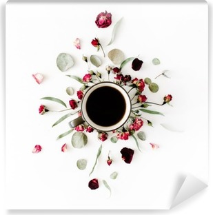 black coffee mug and red rose buds bouquet with eucalyptus on white background. flat lay, top view Vinyl Wall Mural