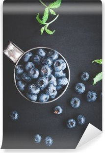 Blueberry on black background. Top view, flat lay Vinyl Wall Mural