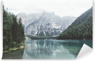 Braies lake with green water and mountains with trees Vinyl Wall Mural