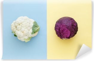 Cauliflower and red cabbage on a bright color background. Seasonal vegetables minimal style. Food in minimal style. Vinyl Wall Mural