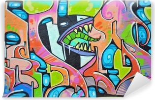 Colorful graffiti painted on a wall outside. Vinyl Wall Mural