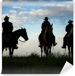 Cowboys on horseback at first light. Silhouettes Vinyl Wall Mural