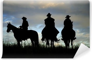 Cowboys on horseback on a Montana ridge at dawn Vinyl Wall Mural